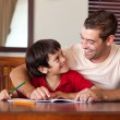 Confident father helping his son for homework — Stock Photo #10311634