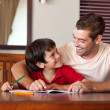 Confident father helping his son for homework — Stock Photo #10311637