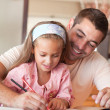 Stock Photo: Cheerful father helping her daughter for homework