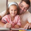 Cheerful father helping her daughter for homework — Foto de Stock