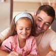Royalty-Free Stock Photo: Cheerful father helping her daughter for homework