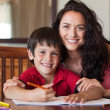 Stock Photo: Happy mother helping his son for homework