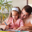 Happy father helping her daughter for homework — Stok fotoğraf