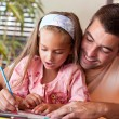 Happy father helping her daughter for homework — Стоковая фотография