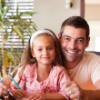 Foto Stock: Happy father helping her daughter for homework