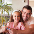 Happy father helping her daughter for homework — Stock Photo