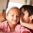 Cute boy talking to his sister — Stock Photo #10311675