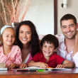 Nice parents helping their children for homework - Foto de Stock  