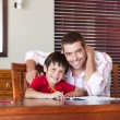 Nice father helping his son for homework - Foto de Stock  