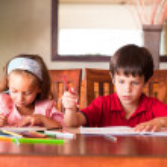 Children doing homework — Stock Photo