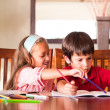 Stock Photo: Children doing homework together