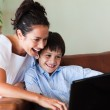 Mother and son having fun with a laptop — Stock Photo