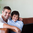 Father and son together with a computer — ストック写真