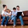 Stock Photo: Family playing together with a laptop