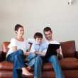 Parents and son playing with a laptop with copy-space — Stock Photo #10311748