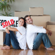Royalty-Free Stock Photo: Lovely couple with unpacking boxes moving to a new house