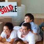 Family buying new house lying on floor — Stock Photo