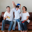 Happy family playing video games in the living-room — Stock Photo #10311829