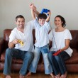 Stock Photo: Happy family playing video games in the living-room