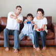 Happy family playing video games in the living-room — Stock Photo