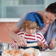 Pretty mother and her son baking at home — Stock Photo