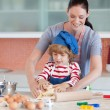 Pretty mother and her son baking at home — Stock Photo #10311874