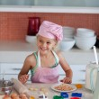 Cute daughter baking in a kitchen — Stock Photo