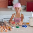Cute daughter baking in a kitchen — Stock Photo #10311913