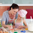 Lovely mother and her daughter baking in a kitchen — Stock Photo