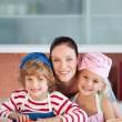 Joyful mother baking with her children — Stock Photo
