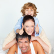 Bright family lying on a white bed — Stock Photo