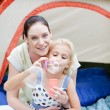 Mother and daughter playing with bubbles — Stock Photo