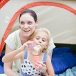 Mother and daughter having fun with bubbles — Stock Photo
