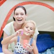 Mother and daughter playing with bubbles — Stock Photo #10312038