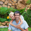Father giving daughter piggyback — Stock Photo