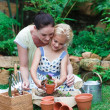 Lovely mother and daughter gardening — Stock Photo