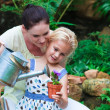 Young mother and daughter watering plants — Stock Photo #10312085
