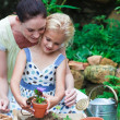 Стоковое фото: Mother and daughter gardening