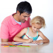 Cheerful father drawing with his daughter — Stock Photo