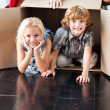 Children having fun in their new house — Stock Photo