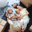 Stockfoto: Family sleeping in its new house