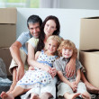 Famiy lying on floor after buying house — Stock Photo