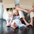 Family having fun after moving house — Stock Photo