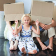 Stockfoto: Family having fun in its new house