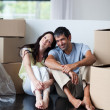 Stock Photo: Happy lovers moving house