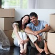 Stock Photo: Happy couple in their new house with copy-space