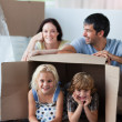 Happy family playing at home with boxes — Stock Photo #10312250