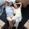Stock Photo: Happy couple relaxing in their new house