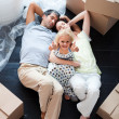 Parents and daughter on the floor with thumbs up — Stock Photo
