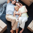 Parents and daughter sleeping on the floor - Stockfoto